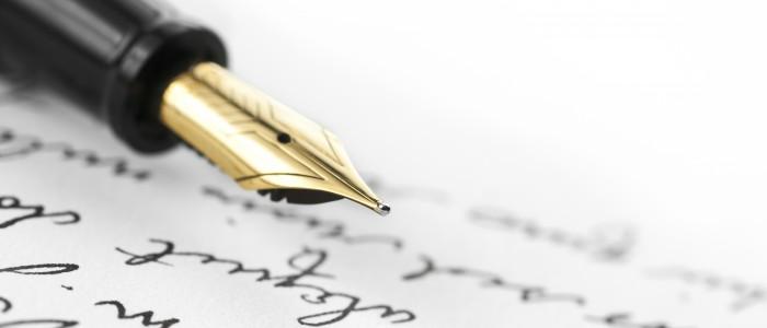 Gold pen on hand written letter